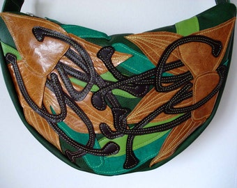 Handmade Crescent Bag in forest green leather with tan appliqued Lilies