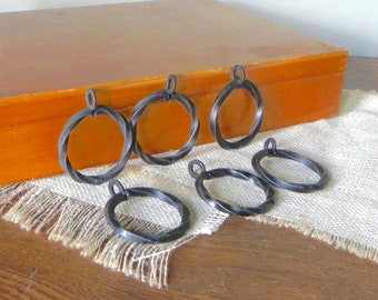 Vintage Cast Metal Curtain RIngs-twisted  set of 6 black iron 2 1/8 inches in diameter.
