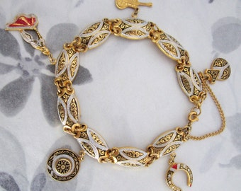 vintage toreador matador themed damascene enamel charm bracelet - j5387