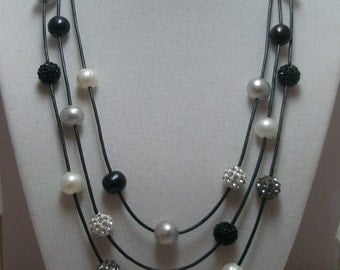 Genuine Pearls and Crystal BallsThree Strand Necklace on Leather  with Pearl toggle clasp