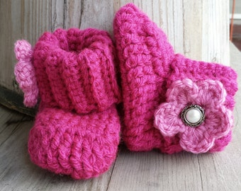 Crochet baby girl boots, in magenta with med. Pink flower and pearl button center. size 0 to 3 mo.