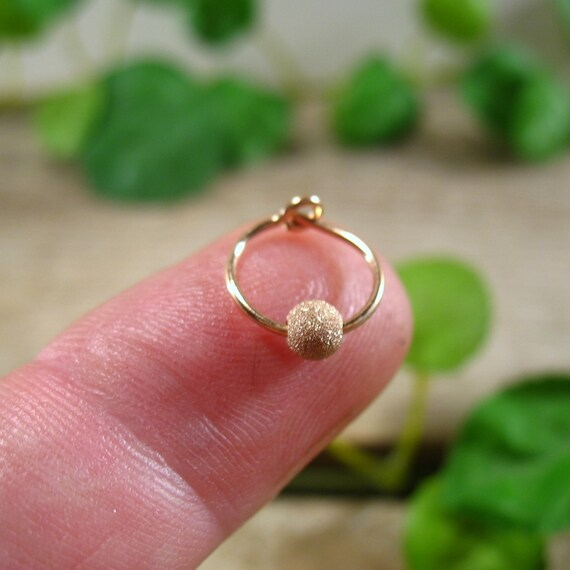 Hoop earrings pink gold with pink gold flecks single piercing lobe