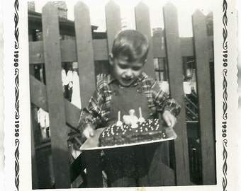 1950 Vintage Snapshot Photo 2 Year Old Boy Carries Birthday Cake Outdoors Photograph