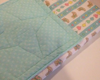 Sweet hand made baby quilt with pocket