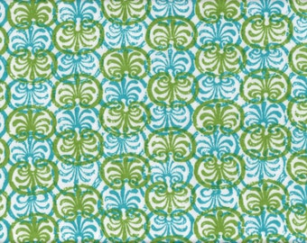 Green and blue design on white knit