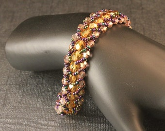 Purple and Gold Woven Seed Bead Bracelet - AB Purple Seed Beads and Lt. Topaz Czech Glass faceted Round Beads and Bicones, Gold Tone Toggle