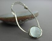 Silver shawl pin or scarf pin in safety pin design with a mother of pearl silver tone button