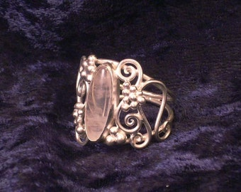 Handmade scrollwork ring with rose quartz size 8.5
