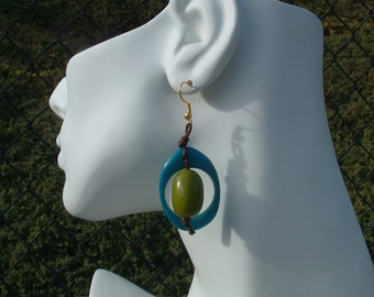 Playful eco-friendly earrings hoops of tagua nuts with seeds color blocking