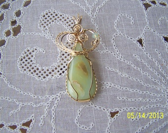 Andes Opal(natural stone) pendant, wrapped in 14K gold filled wire (some twisted), accented with a Swarovski crystal & gold filled beads.