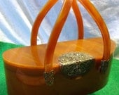 Kidney Shaped WILARDY lucite purse with handle Mirror and latch Brown