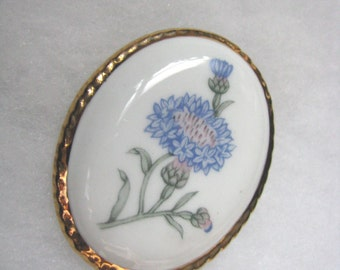 Vintage oval white ceramic brooch pin with blue flowers and gold tone trim
