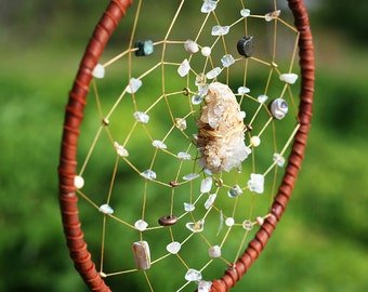 Dreamcatcher, quarts points center, with stones and brass