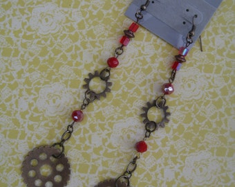 One lovely steampunk gear dangling earrings