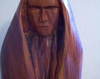 "Cedar Human Figure in Cape, 20"", by Eddie Morrison (Cherokee)"