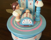 "RESERVED // Lefton angel girl with infant in cradle rotating musical wooden figurine - plays tune ""Rockabye Baby"""