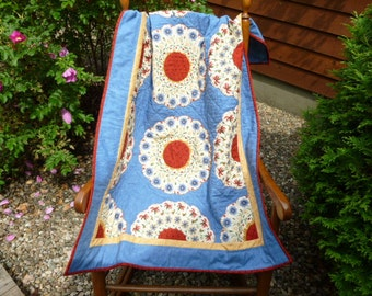 Blue and red quilt wallhanging hand pieced and hand quilted .Made with vintage patches in Dresden Plate pattern