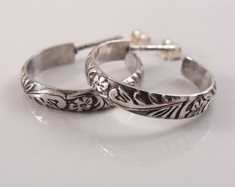 Sterling silver hoop earrings with floral leaf pattern