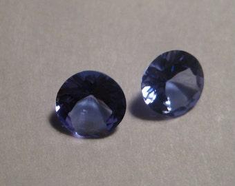 Tanzanite ... faceted gemstones....... 2 pieces.....   5.4 mm round x 2.8 mm .......     a1826