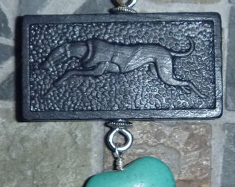 Running Greyhound vintage domino necklace with turquoise heart