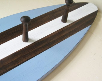"""Wood Surfboard Coat Rack 28"""" with Shaker Pegs Blue, Dark Stain and White"""