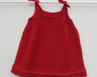 Pinafore dress/tunic top,hand knitted in red wool for a baby girl 3 months to 2 years. MADE TO ORDER