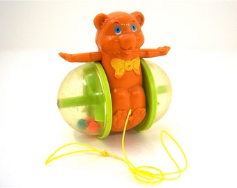 Pull Toy Bob Along Bear No. 642 Vintage Fisher Price collectible for children learing to walk in colorful orange/brown green yellow red blue