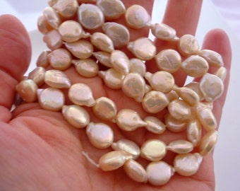 Creamy teardrop coin pearls 11-13mm 1/2 strand