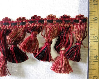 tassel fringe black and different hues of reds and a bit of peach