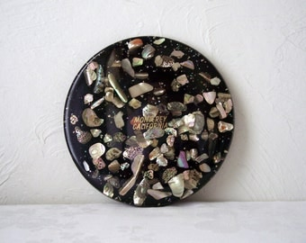 vintage shell trivet - abalone in resin - black - monterey california