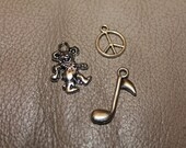 Hippie charm pack, peace sign, grateful dead dancing bear, music note
