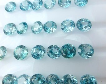 ZIRCON. Blue. Micro Facet.  Bright and Warm medium Blue. Rounds. Great For Studs. 2 pc. 2.0 cts. 5.5mm  (ZIR125)