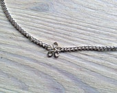 tiny dainty silver flower -necklace (tiny little linear silver flower charm on a silver plated chain)