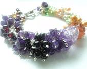 SALE Mixed gemstone, amethyst, garnet, black onyx, freshater pearl statement bracelet.