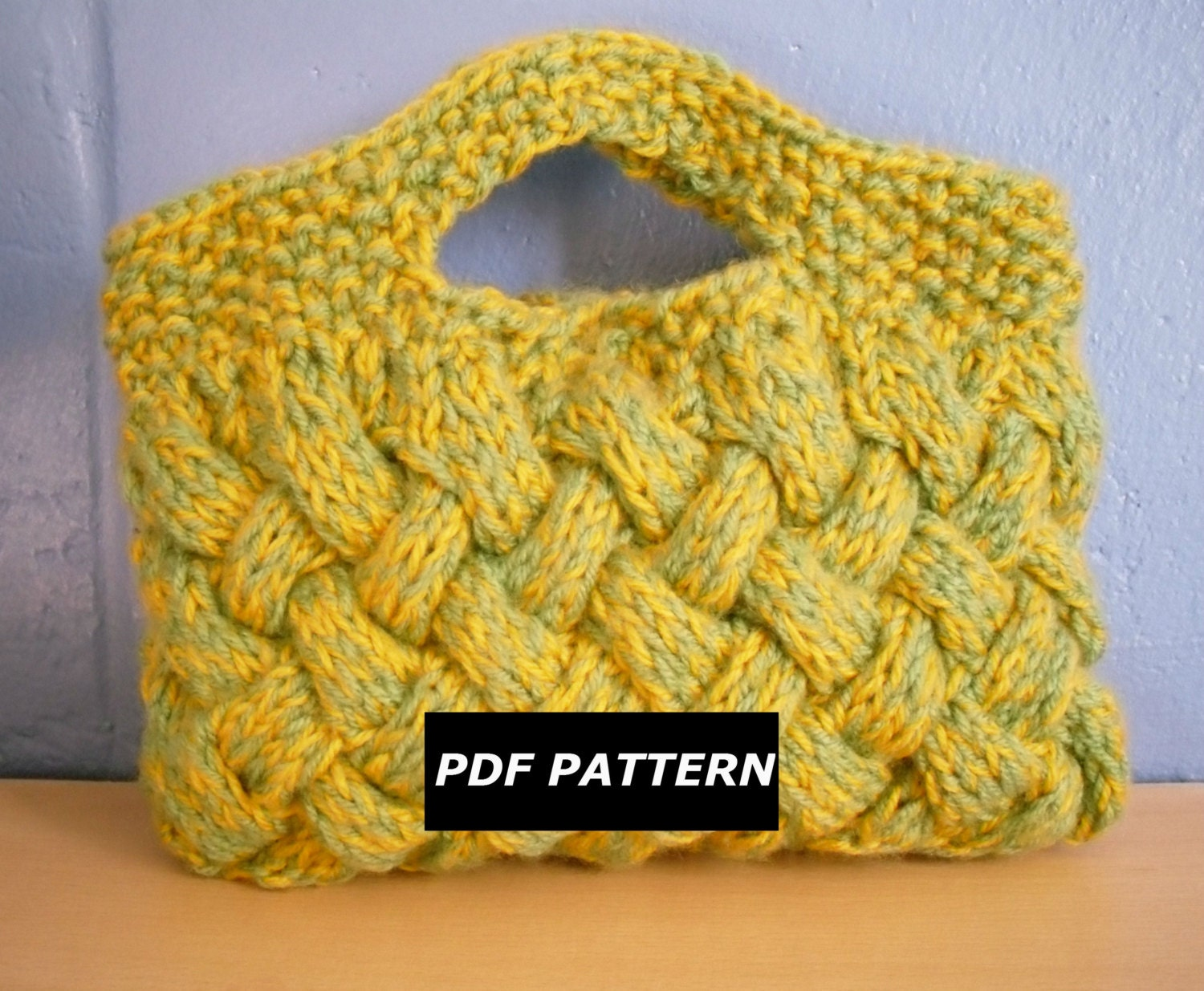 Knitted Clutch Bag Pattern : Knitting Pattern Woven Cable Clutch Bag