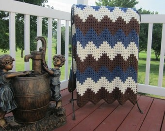 ripple, chevron, crochet blanket, afghan crochet, crocheted blanket, crocheted afghan, brown, blue and ivory