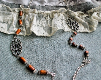 Vintage cross and wood asymmetrical necklace