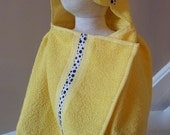 HOODED TOWEL. Bright yellow. White with black polka dotted ribbon. Bumblebee button.