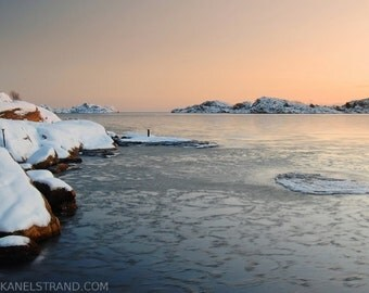 Winter landscape in Norway, frozen sea, dusk, nature photography, travel photography, floating ice