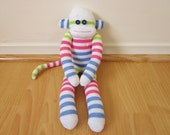 Striped sock monkey with pink, green, and blue stripes in colorblocks - Easter sock monkey