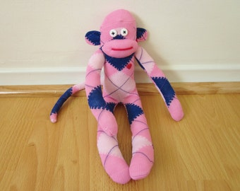 Pink and navy blue argyle sock monkey with red heart