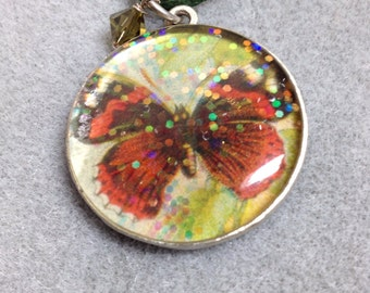Sparkling red butterfly resin pendant