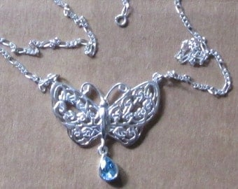 Celtic Knot butterfly with Topaz drop