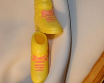 Barbie doll accessory pair of short boots or high top tennis shoes yellow with painted pink laces