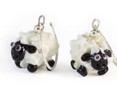 Glass sheep earrings on a sterling silver hook