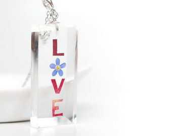 Real flower 'LOVE' resin pendant - clear resin, white gold plated silver necklace