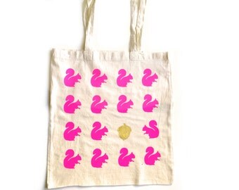 Fall tote bag with neon pink squirrels and gold acorn. Natural cotton.