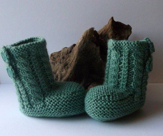 Hand knitted unisex baby booties. 6 12 months. Sage cable