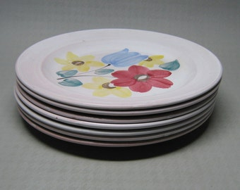 ARABIA of FINLAND hand painted plates in a pattern called ARA flowers  tulip   7 plates salad luncheon plate size .
