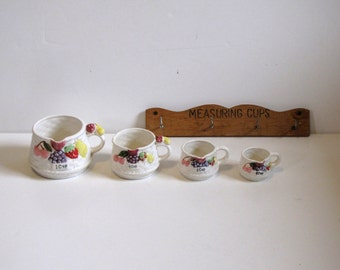 Vintage Tilso Ceramic Measuring Cups with wall hanging rack